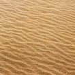 Beach sand waves warm texture pattern - Stock Photo