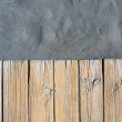 Black beach sand and wooden floor - Stockfoto