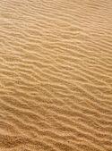 Beach sand waves warm texture pattern — Stock Photo