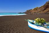 Beach el Bollullo black brown sand and aqua water — Stock Photo
