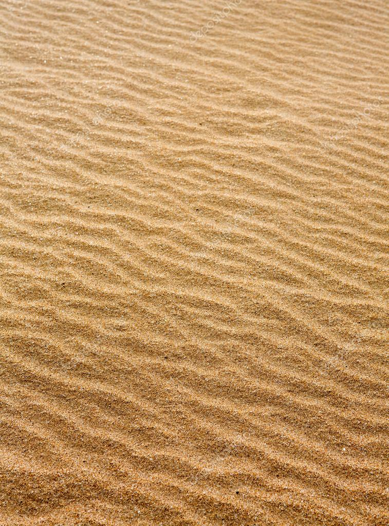 Beach sand waves warm texture pattern background  — Stock Photo #12822376