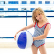 Blond kid girl with swimsuit with summer blue ball — Stock Photo