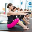 Aerobic Pilates personal trainer in a gym group class - Stock Photo