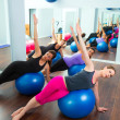 Foto Stock: Aerobic Pilates women group with stability ball