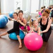 Aerobics pilates women kid girls personal trainer - Stock Photo