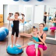 Aerobics woman personal trainer of children girl — Stock Photo #13299114