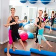 Aerobics pilates women kid girls personal trainer — Stock Photo #13299123