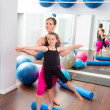 Aerobics woman personal trainer of children girl — Stock Photo #13299135
