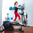 Stock Photo: Aerobics cardio training womon elliptic crosstrainer