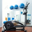 Stock Photo: Aerobics cardio training elliptic crosstrainer at gym