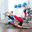 Aerobics pilates gym women group and crosstrainer - Stock Photo
