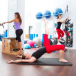 Aerobics pilates gym women group and crosstrainer — Stock Photo #13299343