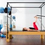 Постер, плакат: Pilates aerobic instructor woman in cadillac