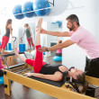 Постер, плакат: Pilates aerobic personal trainer man in cadillac