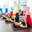 Aerobics pilates women with rubber bands in a row — Stock Photo #13299590