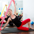 Aerobics pilates women with rubber bands in a row - Stock Photo