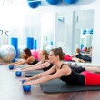 Stock Photo: Aerobics pilates women with toning balls in row
