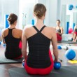 Blue toning ball in women pilates class rear view - Foto Stock
