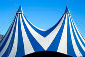 Circus tent stripped blue and white — Stock Photo