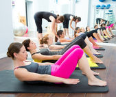Aerobic Pilates personal trainer in a gym group class — Stock Photo