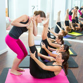 Aerobics Pilates personal trainer helping women group — Stock Photo
