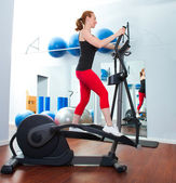 Aerobics cardio training woman on elliptic crosstrainer — Stock Photo