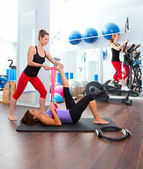 Aerobics pilates gym women group and crosstrainer — Stock Photo