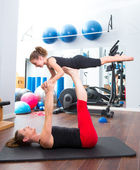 Aerobics woman personal trainer of children girl balance — Stock Photo