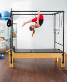 Aerobics pilates instructor woman in cadillac — Stock Photo