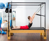 Pilates aerobic instructor woman in cadillac — Stok fotoğraf