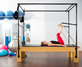 Pilates aerobic instructor woman in cadillac — Stock Photo