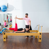 Pilates aerobic personal trainer man in cadillac — Stock Photo
