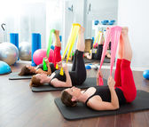 Aerobics pilates women with rubber bands in a row — Stok fotoğraf