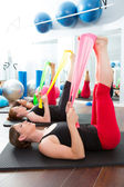 Aerobics pilates women with rubber bands in a row — Stock Photo