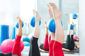 Aerobics pilates women feet with yoga balls — Foto de Stock