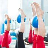Aerobics pilates women feet with yoga balls — Stock Photo