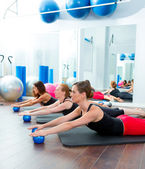 Aerobics pilates women with toning balls in a row — Stock Photo