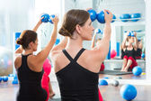 Blue toning ball in women pilates class rear view — Stock Photo