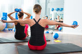 Blue toning ball in women pilates class rear view — Stockfoto