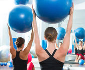 Stability ball in women Pilates class rear view — 图库照片