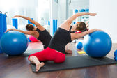 Stability ball in women Pilates class rear view — Stock Photo