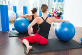 Stability ball in women Pilates class rear view — Foto Stock