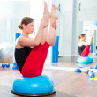 Bosu ball for fitness instructor woman in aerobics - Stock Photo