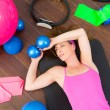 Aerobics woman tired resting lying on mat — Stock Photo #13300262