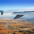 Stock Photo: Airplane takeoff from Madrid barajas in Spain