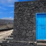 Blue door lava stone masonry wall at La Palma — Stock Photo #13303303