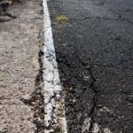 Damaged road grunge paint weathered — Stock Photo
