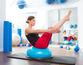 Bosu ball for fitness instructor woman in aerobics — Stock Photo
