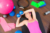 Aerobics woman tired resting lying on mat — Stock Photo