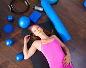 Aerobics woman tired resting lying on mat — Stock Photo